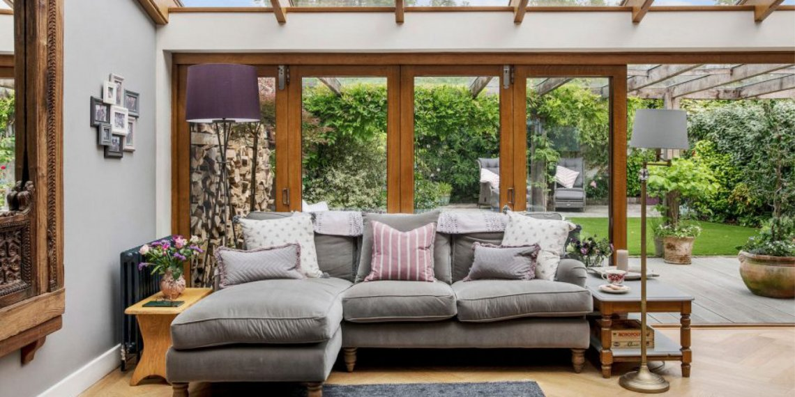Quay View Interior Design Living room with open bifold doors